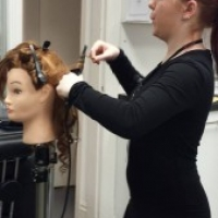 Yazz Academy Students learn blow dry techniques