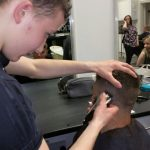 Student learning Barbering Skills with Yazz Academy Begining Barbering Course