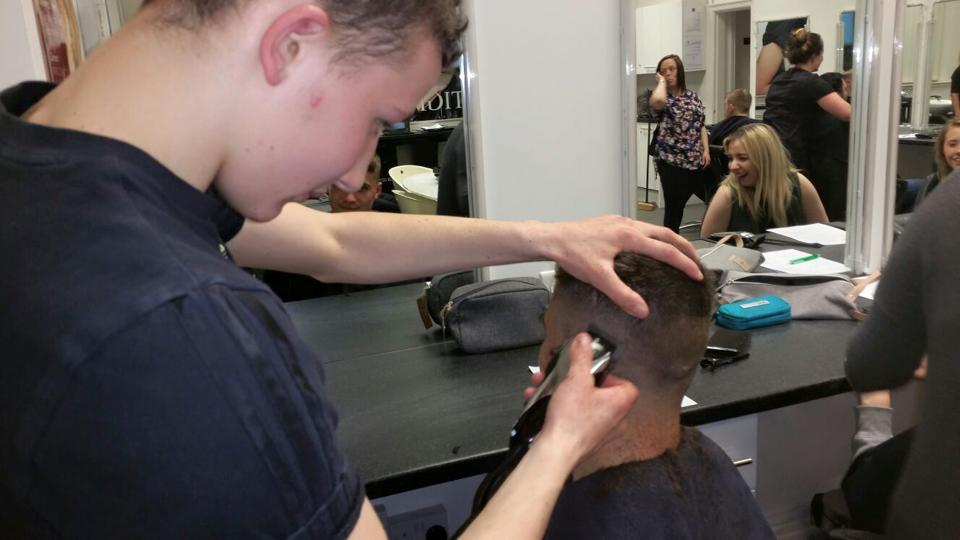 Student learing barbering skills with the Yazz Academy Beginners Barbering Course